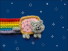 Nyan Cat Bookmark for keeping your place in your comic book.  Crochet it in Bonbons yarn. Pattern by Cute and Kaboodle.