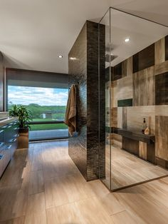 Stunning Brown Bathroom Shower Design With Unique Checkerboard Wall Effect,  Dark Wood Extruded Shelf And Cool Clear Glass Surround