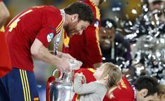 I can tell it is soccer. And whoever that guy is, I love him. So cute with the little girl!