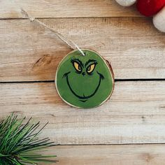 Hand Painted Grinch Wood Slice Ornament | Etsy Wood Slices, Custom Wood, I Am Happy, Grinch, Twine, My Etsy Shop, Hand Painted, Christmas Ornaments, Holiday Decor