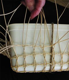 Weaving up the sides of the mould [Photo: G Baxter]