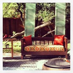 Latest backyard project with my garage sale find, covered a crib mattress, old shutters, & my dumpster side table.