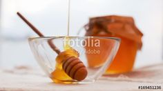 Movie of honey dripping. Traditional celebration food for the Jewish New Year. Concept Rosh Hashana