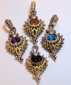 Four peacock charms (clockwise from top): citrine, blue topaz, garnet, amethyst. By Barbara Bixby. Photo by RSBingham