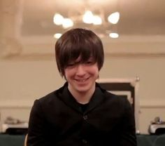 His shy smile is just so ADFSKODVWJ cute <3