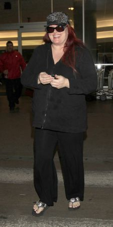 Wynonna Judd is all smiles as she arrives in Los Angeles, CA. The country music legend was seen wearing all black and a hat at LAX.