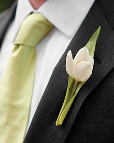 Boutonniere: A single white tulip enveloped in a light-green leaf -- to match his tie -- graces groom David's lapel, a nod to the wedding's springlike feel and palette Tulip Wedding, Green Wedding, Spring Wedding, Our Wedding, Wedding Flowers, Groom Boutonniere, Boutonnieres, Succulent Boutonniere, Tulip Bouquet