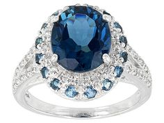 3.85ct Oval And .41ctw Round London Blue Topaz With .27ctw White Zirco