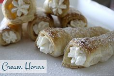 Delicate, flaky puff pastry cones filled with sweet whipped cream.