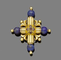 A lapis lazuli and paste cross brooch  The Latin cross with reeded and bead detail set at each end with a lapis lazuli bead, accented with circular-cut paste, glazed compartment to the reverse, engraved 'Anna Maria 13 *** 21 May 1837 Ob77', pin fitting deficient, length 6.5cm