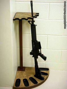 Corner gun rack ~ There are no plans but I think this would be perfect... perhaps a wood post instead of a metal post