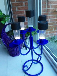 """My cottage deck """"candelabra"""" made from an old candle holder and broken solar lights!!"""