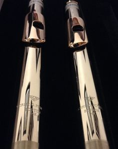 14k white gold Powell Philharmonic flute headjoints, each with a 14k rose gold lip plate and riser.