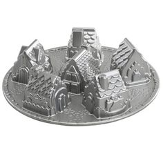 Nordicware. Made in America.  Cozy Village Cake Pan. Scored this on major clearance at TJ Maxx tonight - perfect with the larger version I already own