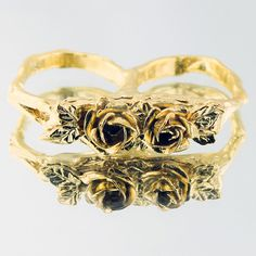 Roses 2 Finger Ring design inspiration on Fab.