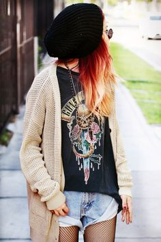 Band tee, shorts, oversized knit cardigan. HER HAIR