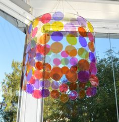 Love this DIY mobile/ lamp shade. Made of skyr quark lids.