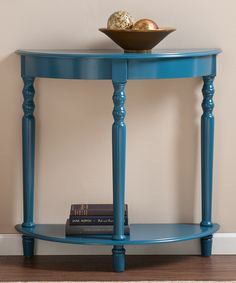 round or square table cut in half and attached at each side of the bed? could be painted cool colors or gold; no drawers though. would need basket or something in bottom shelf;  Southern Enterprises Blue Tyra Demilune Table | zulily