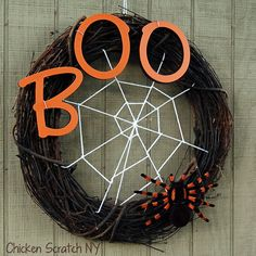 Think outside the box — or in this case, inside the wreath. This blogger weaved a spider web inside a basic vine wreath using white yarn. Get the tutorial at Chicken Scratch NY.