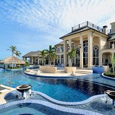 Stunning backyard..this looks like the ultimate beach mansion for a tropical island lovely