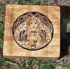 Hand-woodburned Brighid box by the fabulously talented Sleeping Gryphon on Etsy.