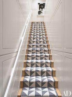 An Ellen von Unwerth photograph surveys the staircase | archdigest.com: