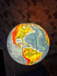 upcycled world globe as creative diy project hanging pendant light