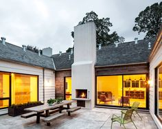 The U-shaped house frames an outdoor room: a courtyard with its own fireplace.