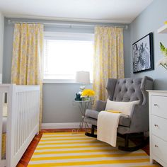 Gray nursery with yellow drapes and nice chair