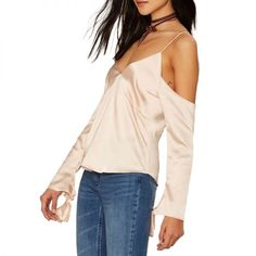 """- """"I'm in the market for a flirty top to wear on Valentine's Day, and I've basically found the perfect option. This silky satin blouse with cold-shoulder details and romantic sleeves with ties is everything I've ever wanted. I plan to pair it with skinny jeans, ankle-strap heels and a fun clutch.""""—Amy Lee, Associate Fashion EditorNasty Gal Odette Satin Blouse, $58"""