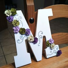 "White wooden ""M"" decorated with pre-shaped, stick on rhinestones and stick on purple and green flowers. It's going to match my room at college perfectly! [my first attempt at crafting something with ideas i got from pinterest]"