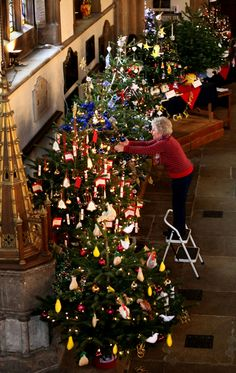 Charles visit to Bedfordshire. Sheila Smith from the Mothers Union, at St PaulÕs Church in Bedford, makes some final adjustments to Christma...