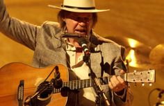 Neil Young with Hank Williams' 1941 Martin D-28, which he bought as an homage