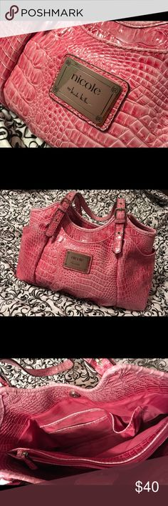 Nicole Miller Purse. Pink Super Chic pink purse with lots of pockets. This purse is new without tags. The hardware is in great shape. No tears, odors or wear. The inside is clean and it has 3 main compartments two with zippers. The 3rd one has 3 pockets. The outside has side, font & side pockets. Nicole by Nicole Miller Bags Satchels