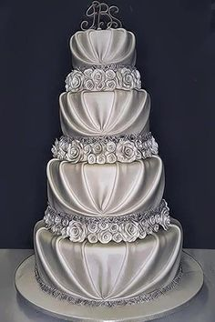www.cakecoachonline.com – sharing...Extravagant silver rose four tier wedding cake