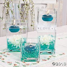 Floating Candle Centerpieces (water beads and floating candles) Pearl Centerpiece, Floating Candle Centerpieces, Hanging Candles, Water Beads Centerpiece, Vases, Centerpiece Ideas, Teal Wedding Centerpieces, Silver Candles, Turquoise Centerpieces