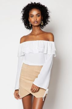 Galanga Top White.  Off-shoulder neckline, check! Cute ruffles, check! Loose-fitting, check! Galanga will see you through this season in style. Tuck it into a high-waist skirt and add statement earrings.