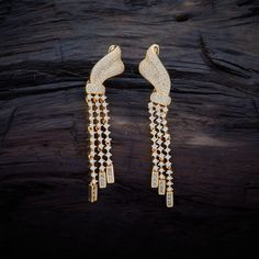 Trendy CZ Zircon Hanging earrings studded with White synthetic stones, with gold Polish.
