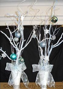 Winter Wonderland sweet 16 centerpieces: In 2009 I made a sweet 16 themed party for my daughter. I made everything including invitations, table centerpieces, personalized party favor ornaments,