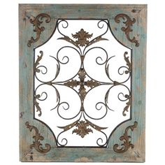 """Let country-chic flair lead the way! This gorgeous Rustic Turquoise Wood & Metal Wall Decor features a distressed turquoise wooden frame surrounding a rusty metal swirl, flower, and scallop design, along with coordinating metal accents on each corner of the frame. Incredibly vintage-inspired, this piece will make a stunning statement in your home or office!    Dimensions:      Length: 29 3/4""""    Width: 24""""    Thickness: 1 1/2""""      Hanging Hardware:      2 ..."""