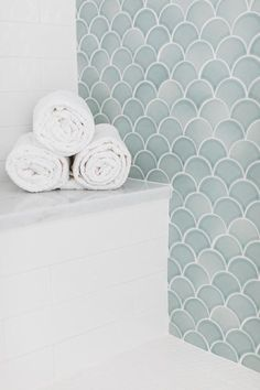 A white tiled bench with a marble top is fitted against white staggered backsplash tiles and adjacent to a seafoam green tiled accent wall. Marble Tile Bathroom, Bathroom Floor Tiles, Seafoam Bathroom, Bad Inspiration, Bathroom Inspiration, Bathroom Ideas, Shower Ideas, Scallop Tiles, Patterned Wall Tiles