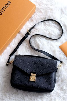 9715a3cf3d13 The Louis Vuitton Pochette Metis in black monogram empreinte leather with  gold hardware