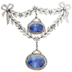 Belle Epoque Certified Ceylon Sapphire Diamond Gold Platinum Brooch Pin. Fairy Unheated Ceylon Sapphire and Diamond brooch from the Belle Epoque era. Circa 1905. In the garland style, designed as tied ribbon bows with scrolls and articulated floral swags, featuring two sapphire and diamond set drop pendants. cinco 1900-1909