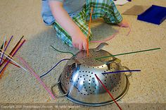 Grab a pack of colored pipe cleaners from your local craft store (usually these cost about 0.99 cents), then show your little one how to thread them through the holes of a colander. Sounds simple I know, but for a young toddler this is fascinating stuff. Fuzzy, multi-colored, bendy things that can be pushed through shiny holes! I mean, come on, how can you resist?