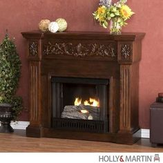Holly and Martin Huntington Gel Fireplace - Espresso - HM-37-131-031-6-12. HM-37-131-031-6-12 - Holly and Martin Huntington Gel Fireplace - Espresso An elegant floral design across the top of this rich espresso fireplace draws attention. Fluted columns on either side of the firebox provide a unique el.. . See More Gel Fireplaces at http://www.ourgreatshop.com/Gel-Fireplaces-C713.aspx