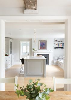 Large island with some seating Large cupboard for pans in side nearest the Aga Like the pale colour with the warmer floor
