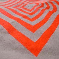 neon orange on unbleached canvas