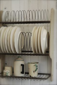 sideways plate rack - I think this is how kitchen cupboards should be designed when used for dishes.
