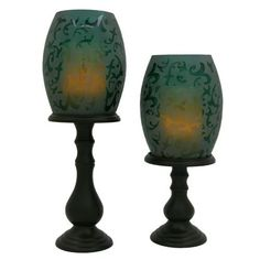 Wilmington Flameless Candle Hurricane Lamps - Set of 2 (Cranberry) by Flipo. Save 30 Off!. $61.24. Color: Cranberry. Convenient on/off timers allow the candles to illuminate for your choice of four or eight hours at the same time each day.. Add elegance to any room in your home with this set of two hurricane lamps. Featuring gracefully handcrafted turned wood bases. Each holds an exquisite etched glass shade that conceals a flameless candle. Etched Hurricane Holders w/ Flameles...