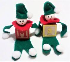 CH-101, $4.98, Two Little Christmas Elves with Toy Block Bodies and Pom Poms.